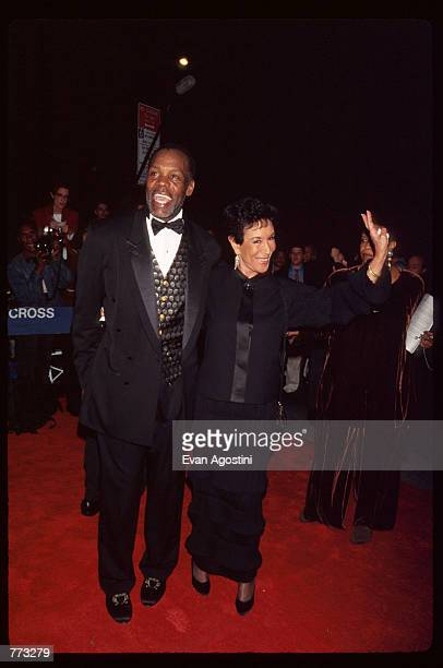 Actor Danny Glover and Mrs Harry Belafonte attend the premiere of the film Cry the Beloved Country at the Ziegfeld Theatre October 23 1995 in New...