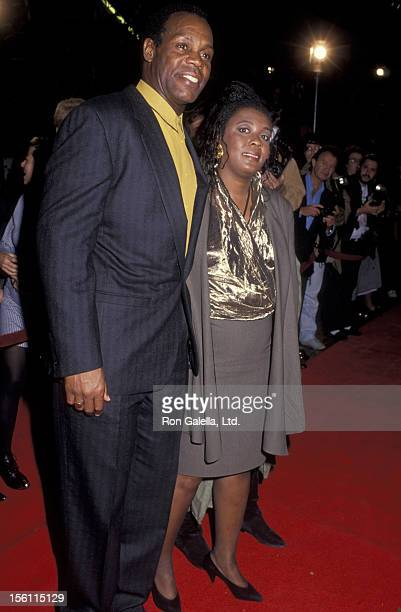 Actor Danny Glover and wife Asake Bomani attending the premiere of 'Predator 2' on November 19 1990 at Westwood Avco Theater in Westwood California