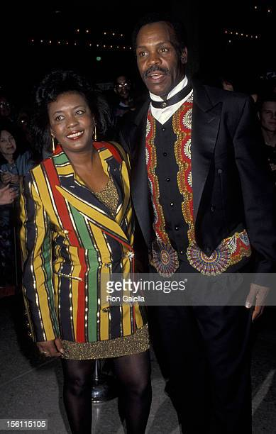 Actor Danny Glover and wife Asake Bomani attending the premiere of 'Grand Canyon' on December 15 1991 at the Cineplex Odeon Cinema in Century City...