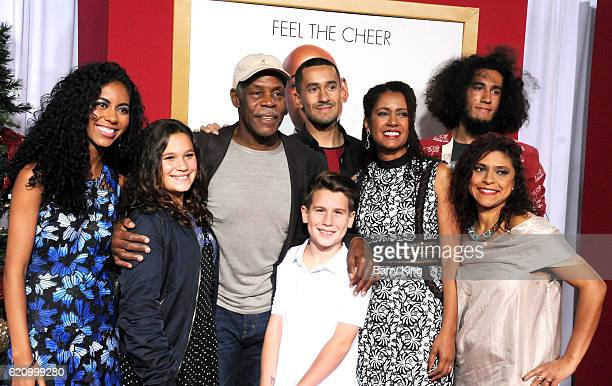 Actor Danny Glover and wife Elaine Cavalleiro and family attend the premiere of Universal's 'Almost Christmas' at Regency Village Theatre on November...