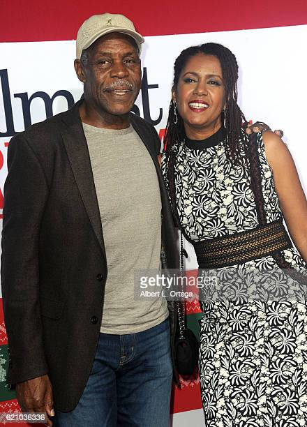 Actor Danny Glover and wife Eliane Cavalleiro arrive for the Premiere Of Universal's Almost Christmas held at Regency Village Theatre on November 3...