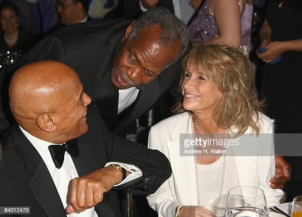 Actor Danny Glover greets Harry Belafonte with his wife Pamela during The 2nd Annual amfAR Cinema Against AIDS Dubai Gala held at the Atlantis The...