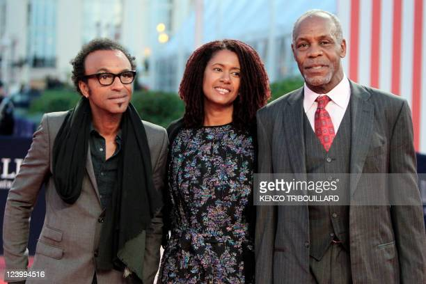 US actor Danny Glover his wife Asake Bomani and French musician Manu Katché hit the red carpet before a homage ceremony during the 37th US Film...