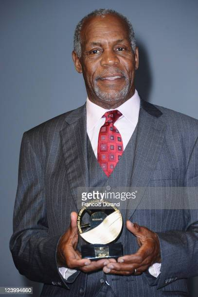 S actor Danny Glover poses with his award during a tribute for his career in film during the 37th Deauville American Film Festival on September 7...