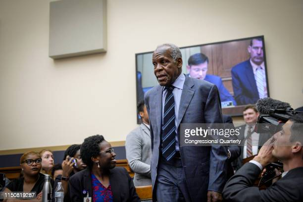 Actor Danny Glover walks in before testifying about reparations for the descendants of slaves during a hearing before the House Judiciary...