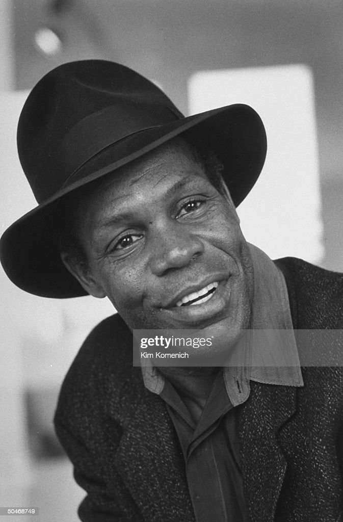 Actor Danny Glover wearing hat in Allrich Gallery.