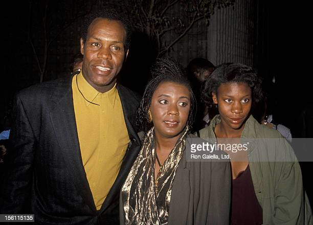 Actor Danny Glover wife Asake Bomani and Mandisa Glover attending the premiere of 'Predator 2' on November 19 1990 at Westwood Avco Theater in...