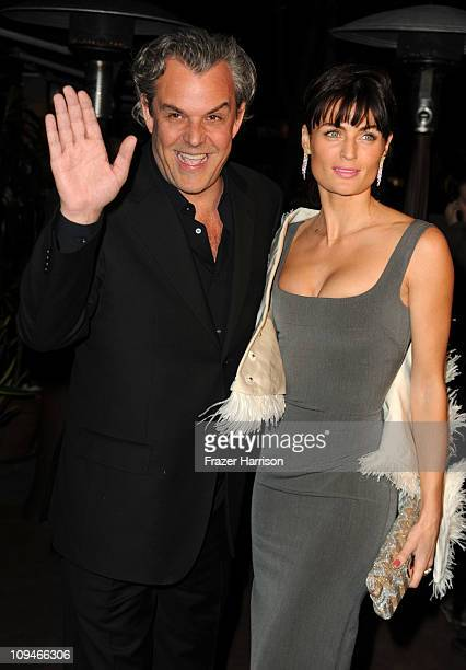 Actor Danny Huston and Lyne Renee arrives at the Chanel and Charles Finch Pre-Oscar Dinner at Madeo Restaurant on February 26, 2011 in Los Angeles,...