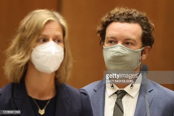 Actor Danny Masterson stands with his lawyer Sharon Appelbaum as he is arraigned on three rape charges in separate incidents between 2001 and 2003 at...
