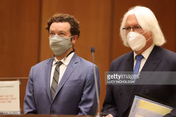 Actor Danny Masterson stands with his lawyer Thomas Mesereau as he is arraigned on three rape charges in separate incidents in 2001 and 2003 at Los...