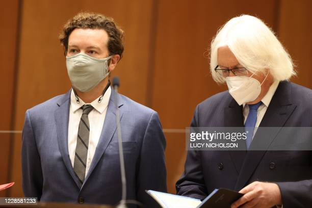 Actor Danny Masterson stands with his lawyer Thomas Mesereau as he is arraigned on three rape charges in separate incidents between 2001 and 2003 at...