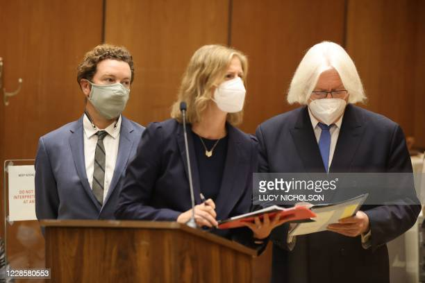 Actor Danny Masterson stands with his lawyers Thomas Mesereau and Sharon Appelbaum as he is arraigned on three rape charges in separate incidents in...