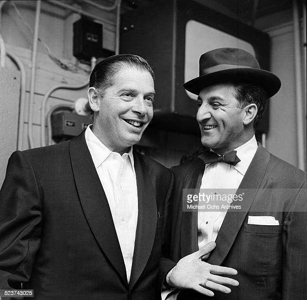 Actor Danny Thomas poses with Milton Berle gets ready to perform at the Hollywood Bowl in Los Angeles,CA.