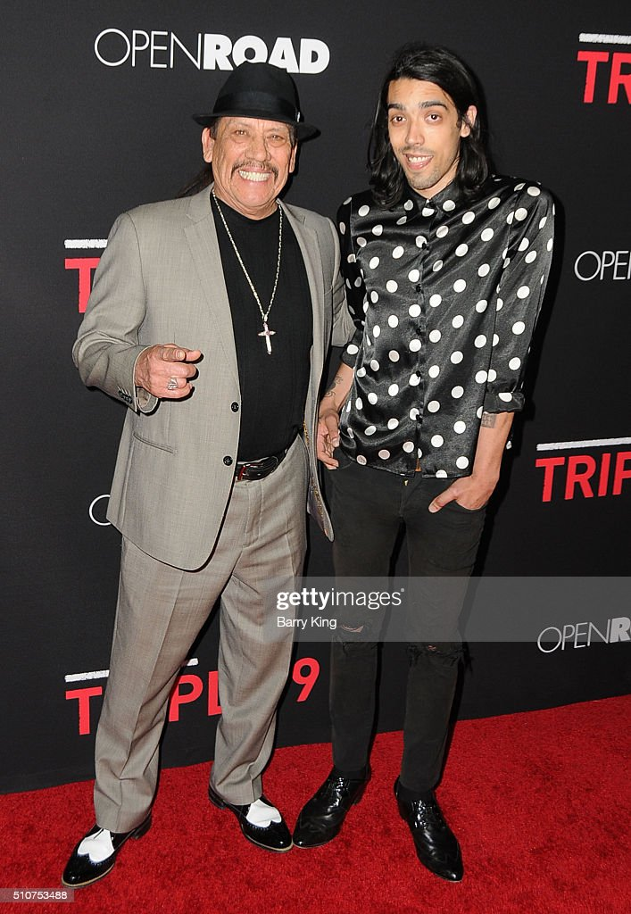Actor Danny Trejo and son actor Gilbert Trejo attend the Premiere of Open Road's 'Triple 9' at Regal Cinemas L.A. Live on February 16, 2016 in Los Angeles, California.