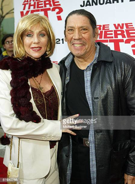 Actor Danny Trejo and wife Debbie pose on the red carpet during the premiere of Are We There Yet at the Mann Village on January 9 2005 in Los Angeles...
