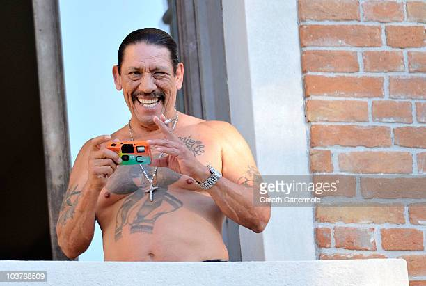 Actor Danny Trejo looks out from his hotel balcony during the 67th Venice Film Festival on September 1 2010 in Venice Italy