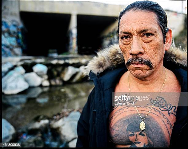Actor Danny Trejo poses for a magazine editorial in 2006 in the LA River in 2006 in Los Angeles