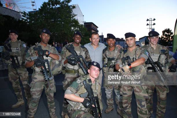 Actor Dany Boon here posing with soldiers of the Sentinel Force attends the Photocall of the movie Le Dindon during the 12th Angouleme FrenchSpeaking...