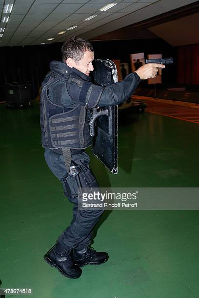 COVERAGE Actor Dany Boon performs with the RAID at 'La Maison du RAID' for the Filming of a sequence for 'Une nuit avec la Police et la Gendarmerie'...