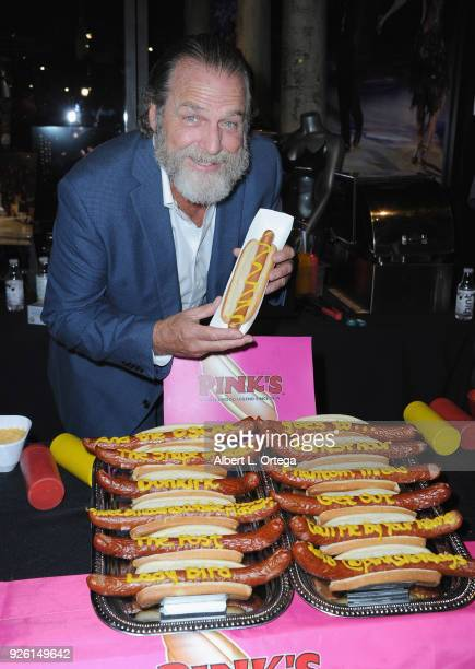 Actor Darby Hinton poses with a hot dog from Pink's at The Hollywood Chamber's Awards Media Welcome Center held at The Hollywood Museum on March 1...