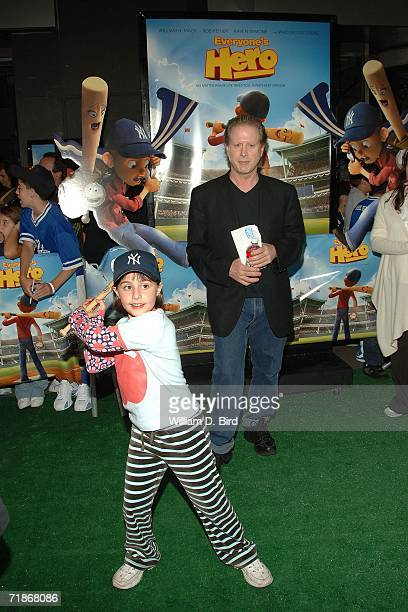 "Actor Darrell Hammond watches as his his daughter, Mia takes a swing with a bat at the New York premiere of ""Everyone's Hero"" at the AMC Loews..."