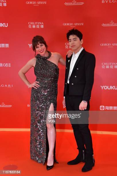 Actor Darren Wang Talu and actress Milla Jovovich attend the Closing and Golden Goblet Awards Ceremony of the 22nd Shanghai International Film...