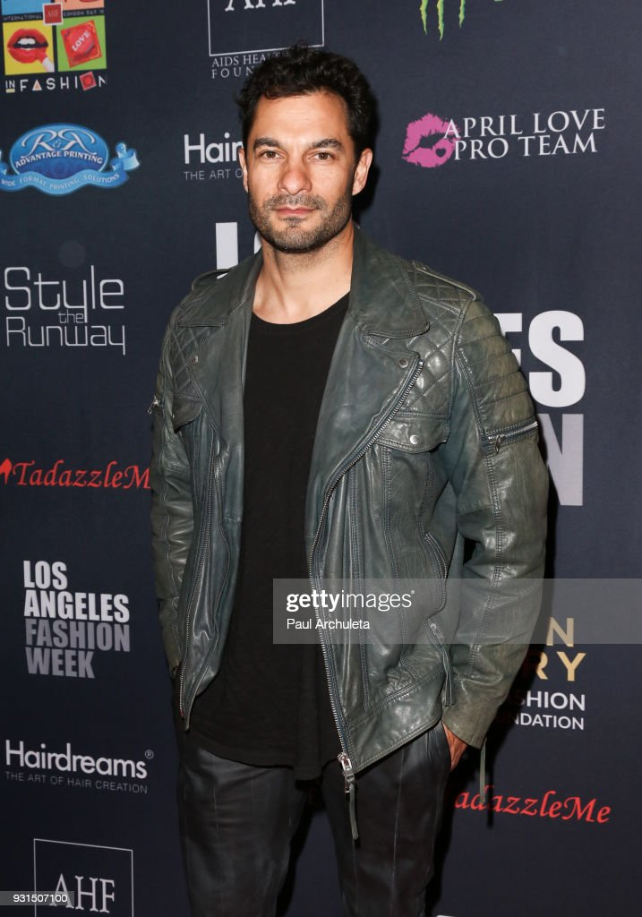 Actor Darwin Shaw attends the Domingo Zapata Fashion Show at the Los Angeles Fashion Week 10th season anniversary at The MacArthur on March 12, 2018 in Los Angeles, California.