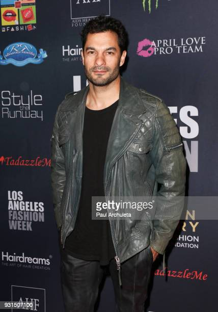 Actor Darwin Shaw attends the Domingo Zapata Fashion Show at the Los Angeles Fashion Week 10th season anniversary at The MacArthur on March 12 2018...
