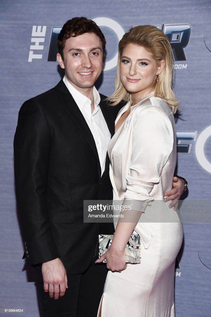 Actor Daryl Sabara (L) and singer Meghan Trainor arrive at FOX's 'The Four: Battle For Stardom' Season Finale Viewing Party at Delilah on February 8, 2018 in West Hollywood, California.