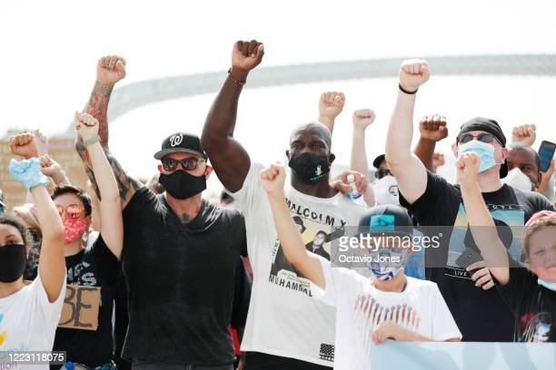 Actor Dave Bautista and WWE wrestler Titus O'Neil take a group photo with supporters during the Love Walk on June 27 2020 in downtown Tampa Florida...