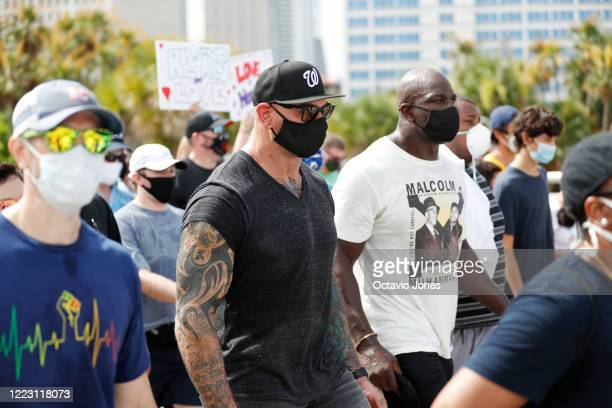 Actor Dave Bautista walks with WWE wrestler Titus O'Neil during the Love Walk on June 27 2020 in downtown Tampa Florida Thaddeus Bullard also known...