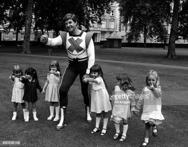 Actor Dave Prowse who plays Darth Vader in Star Wars in his role as the Green Cross Code Man with the six finalists in the 1981 'Miss Pears' contest...