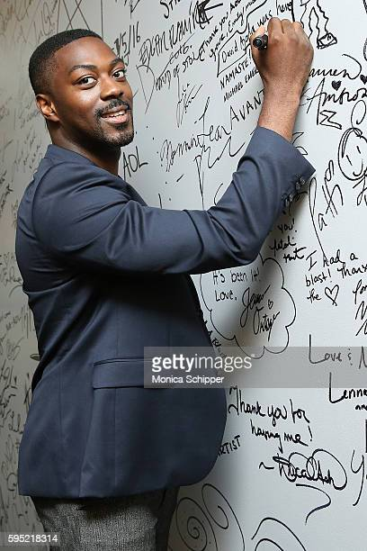 Actor David Ajala signs the wall at AOL HQ when he visits for AOL Build Presents David Ajala discussing The USA Network's Falling Water at AOL HQ on...