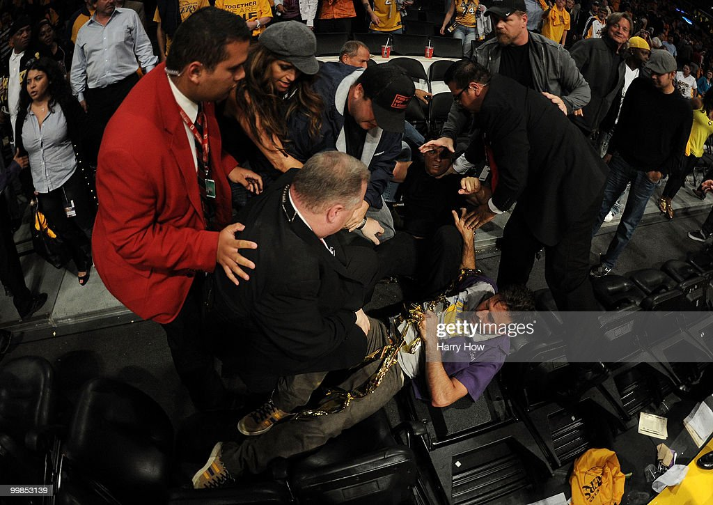 Actor David Arquette (C) is knocked to the floor at the end of game between the Los Angeles Lakers and the Phoenix Suns in Game One of the Western Conference Finals during the 2010 NBA Playoffs at Staples Center on May 17, 2010 in Los Angeles, California.