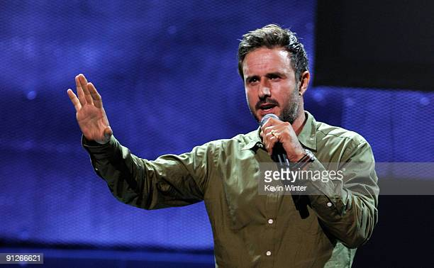 Actor David Arquette speaks onstage during the Rock A Little, Feed Alot benefit concert held at Club Nokia on September 29, 2009 in Los Angeles,...