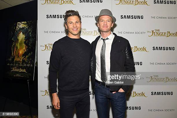 Actor David Burtka and actor Neil Patrick Harris attend as Disney with The Cinema Society Samsung host a screening of 'The Jungle Book' at AMC Empire...