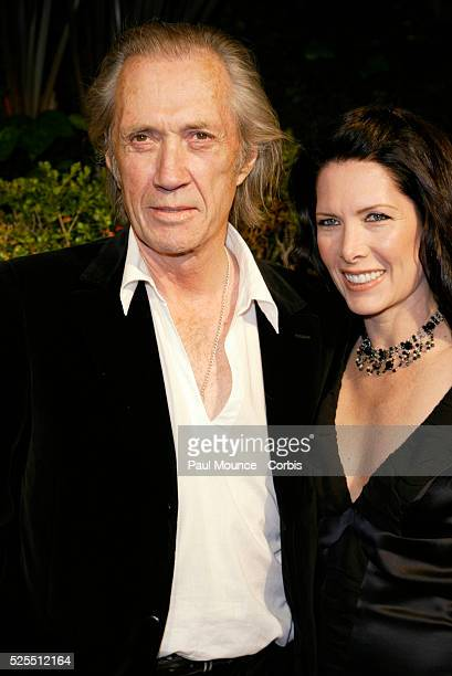 Actor David Carradine and wife arrive at the Miramax PreOscar 2004 Max Awards party at the StRegis Hotel