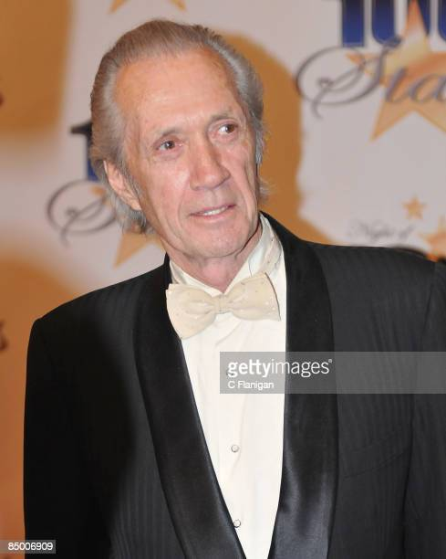 """Actor David Carradine and wife attend The 19th Annual """"Night of 100 Stars"""" Gala at The Beverly Hills Hotel on February 22, 2009 in Beverly Hills,..."""