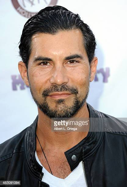 Actor David De Santos arrives for the 2014 Etheria Film Night held at American Cinematheque's Egyptian Theatre on July 12 2014 in Hollywood California