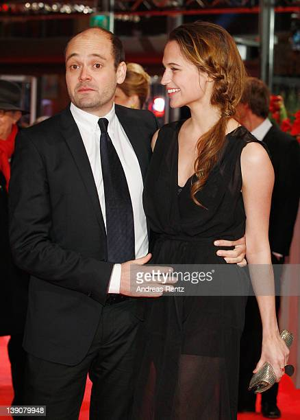Actor David Dencik and actress Alicia Vikander attends the En Kongelig Affaere Premiere during day eight of the 62nd Berlin International Film...