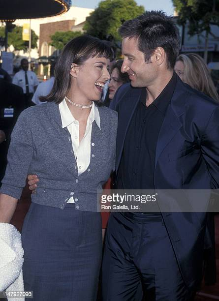 Actor David Duchovny and actress Tea Leoni attend The XFiles Westwood Premiere on June 11 1998 at the Mann Village Theatre in Westwood California