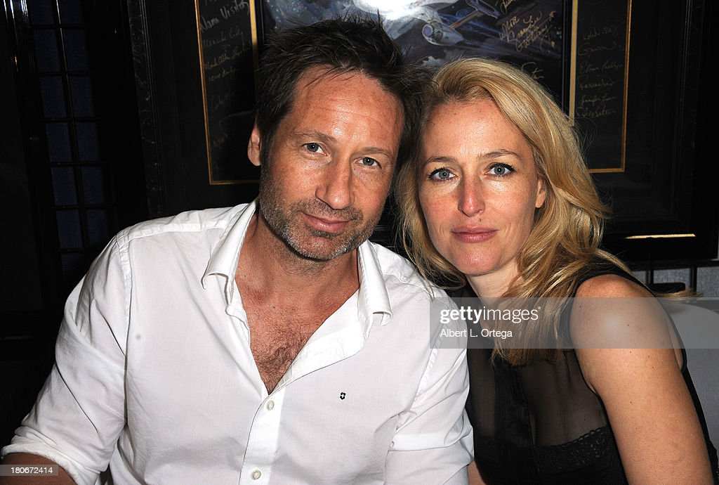 Actor David Duchovny and Gillian Anderson of 'The X-Files' sign autographs at the LightSpeed Booth on the convention floor on Day 1 of the 2013 Comic-Con International - General Atmosphere held at San Diego Convention Center on Thursday July 18, 2012 in San Diego, California.