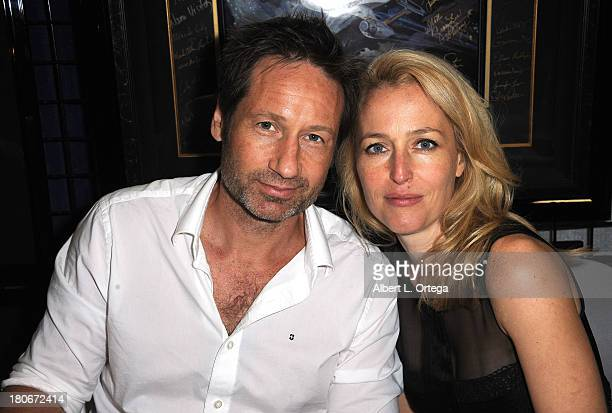 Actor David Duchovny and Gillian Anderson of The XFiles sign autographs at the LightSpeed Booth on the convention floor on Day 1 of the 2013 ComicCon...