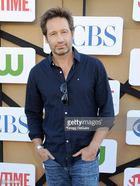 Actor David Duchovny arrives at the CBS/CW/Showtime Television Critic Association's summer press tour party at 9900 Wilshire Blvd on July 29 2013 in...