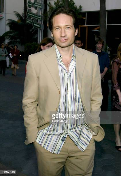 Actor David Duchovny attends the world premiere of the film Connie and Carla at the Universal Studios Cinema on April 13 2004 in Universal City...