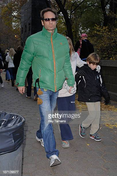 Actor David Duchovny Madelaine West Duchovny and Kyd Miller Duchovny walk in Midtown Manhattan on November 24 2010 in New York City