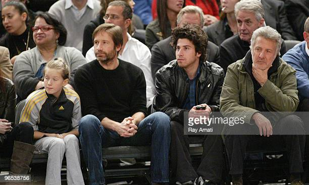 Actor David Duchovny with his daughter Madelaine and Actor Dustin Hoffman with his son Jacob all watch the New York Knicks go up against the...
