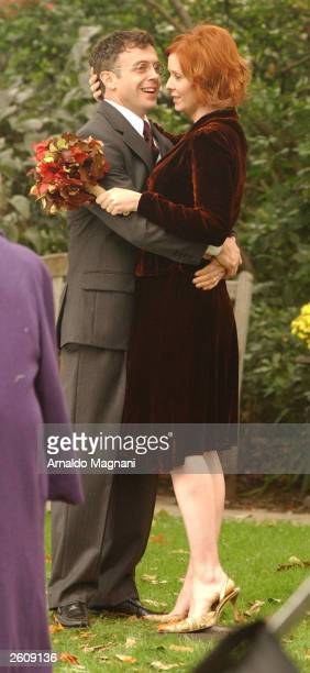 Actor David Eigenberg hugs actress Cynthia Nixon during taping of an episode of Sex and the City October 17 2003 in New York City