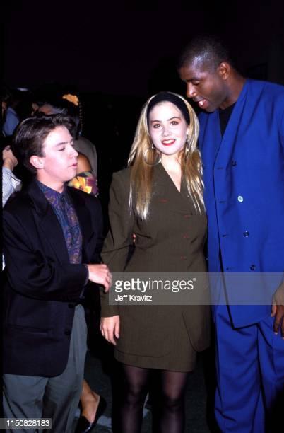 Actor David Faustino Actress Christina Applegate and Basketball Player Magic Johnson at the 1990 MTV Video Music Awards at in Los Angeles California