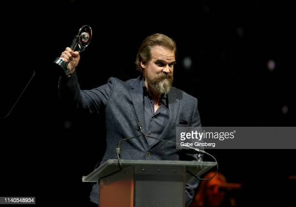 """Actor David Harbour accepts the """"Action Star of the Year"""" award during the CinemaCon Big Screen Achievement Awards at The Colosseum at Caesars Palace..."""